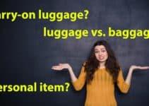 Bild zeigt eine verwirrte Frau, die sich Gedanken zu den möglichen englischen Übersetzungen für Gepäckbegriffe macht